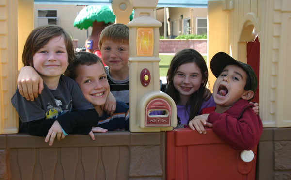Young pals gather inside playhouse on South Courtyard